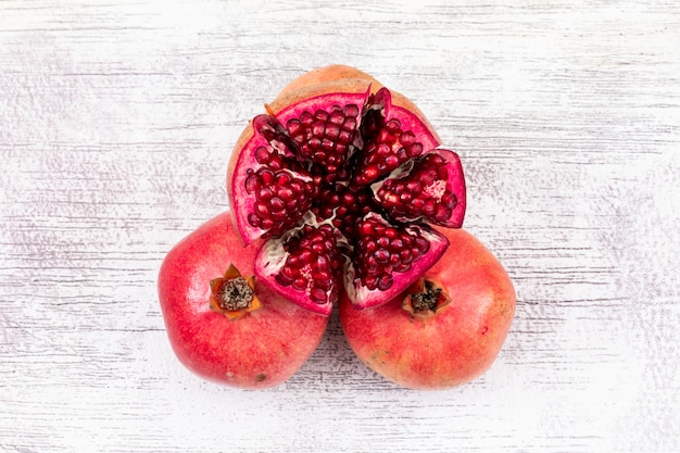 Fresh pomegranate top view on white wooden surface