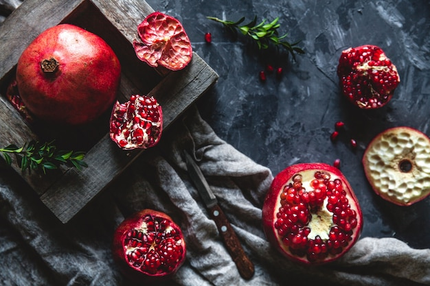 Fresh pomegranate in a wooden box