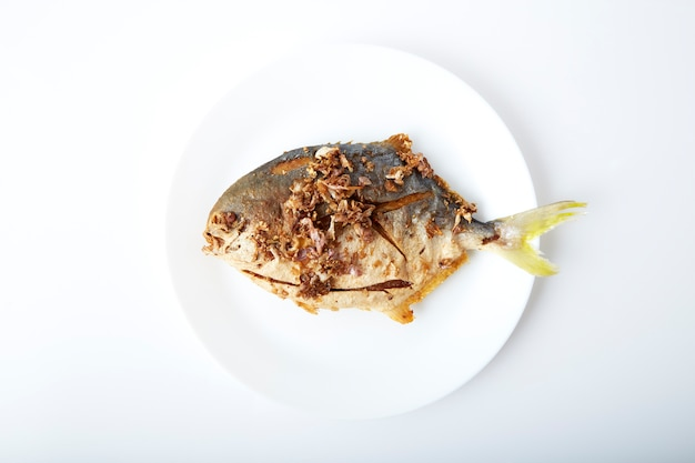 Fresh pomfret deep fried in dish