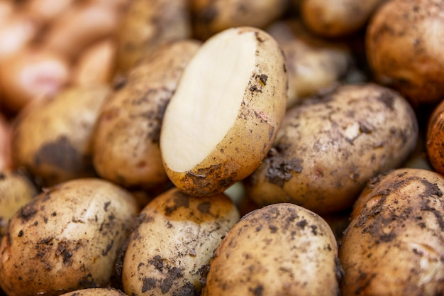 Fresh potato crop on a market counter. close-up. healthy eating and vegetarianism.