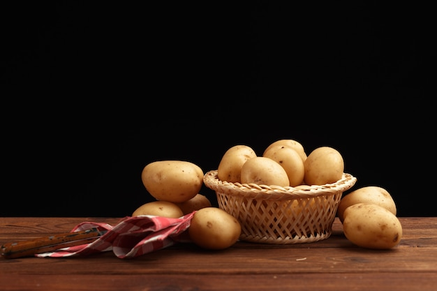 Fresh potatoes in basket
