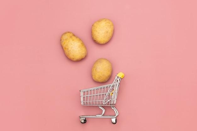 Fresh potatoes and supermarket cart