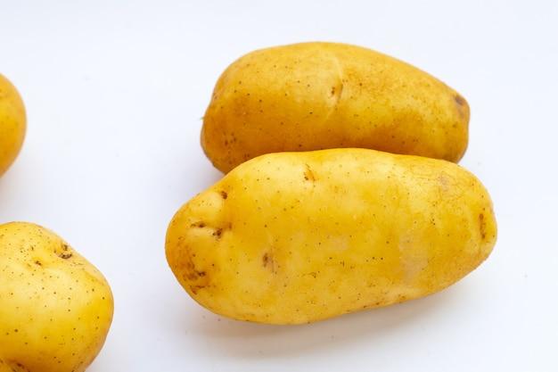 Fresh potatoes on white background.