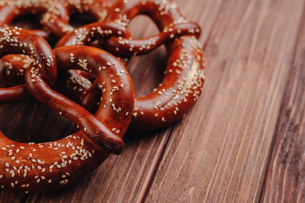 Fresh pretzel sprinkled with sesame seeds