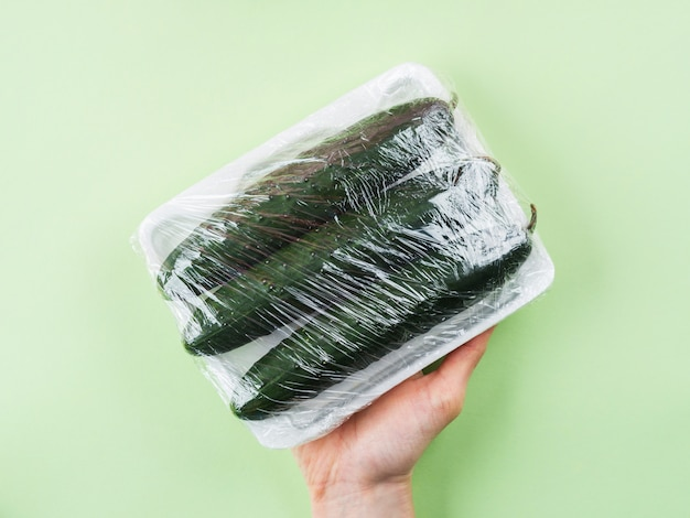 Fresh produce wrapped in plastic film.