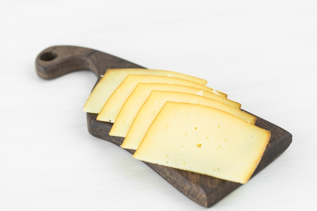 Fresh products. sliced cheese on rustic table.