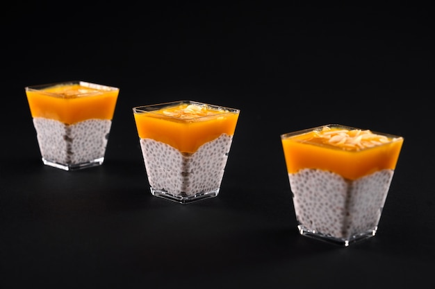 Fresh pudding with natural organic soya milk, chia seeds and mango puree