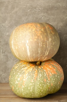 Fresh pumpkin on grey wooden background with copy space. top view