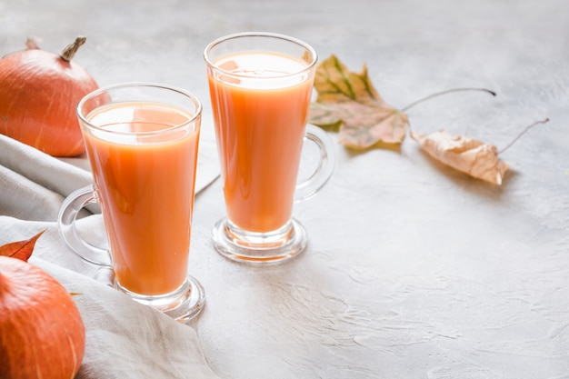 Fresh pumpkin smoothie or juice. autumn, fall or winter hot drink. cozy healthy beverage.