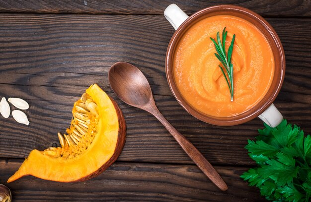Fresh pumpkin soup in a ceramic plate