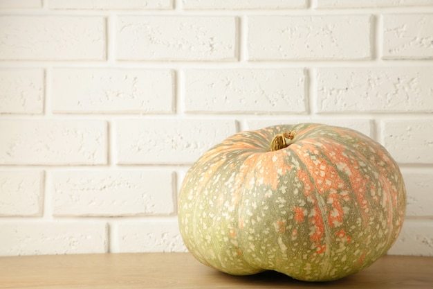 Fresh pumpkin on white background with copy space. top view