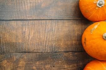 Fresh pumpkins on table