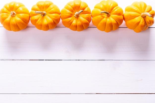 Fresh pumpkins on white surface