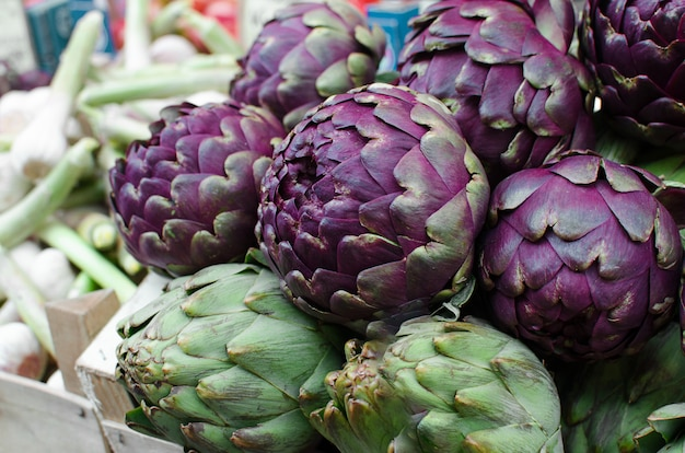 Fresh purple artichokes on in the fruit market.