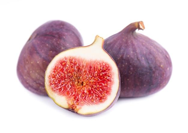 Fresh purple fig fruit isolated on white. ripe fig fruit.