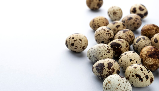 Fresh quail eggs isolated on white background with copy space for text