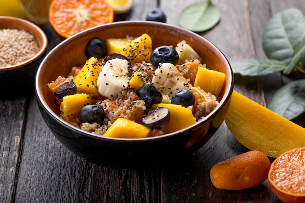 Fresh quinoa organic fruit salad in bowl