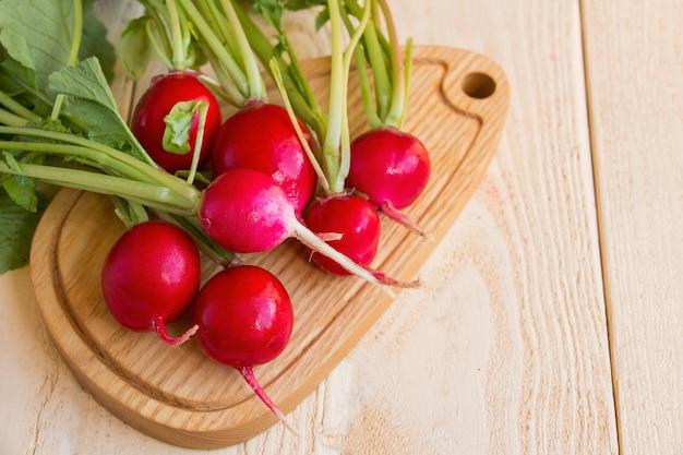 Fresh  of radish on wooden table