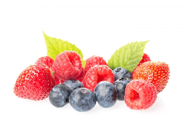 Fresh raspberries, blueberries, blackberries and strawberry with leaves isolated