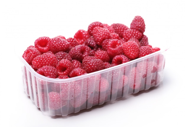 Fresh raspberries in the plastic box