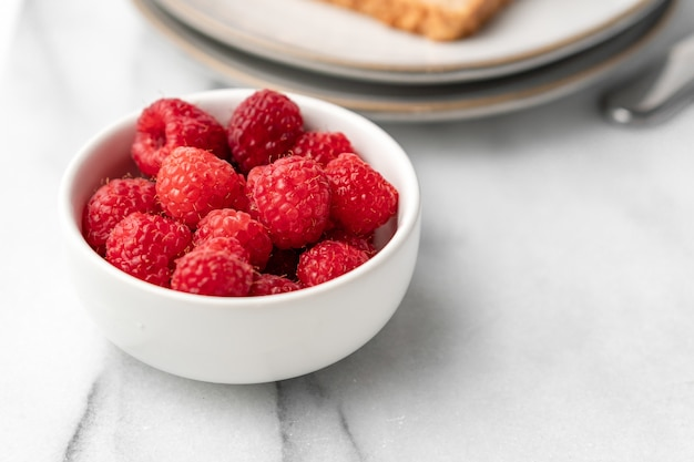 Fresh raspberries on the table for breakfast