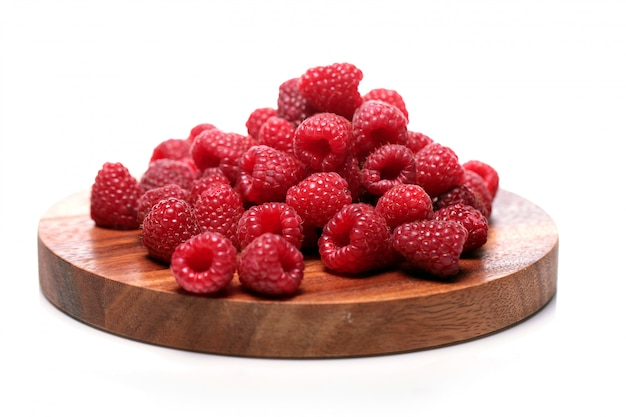 Fresh raspberries on wooden surface