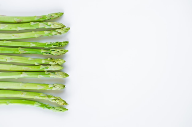 Fresh raw asparagus, background with copyspace