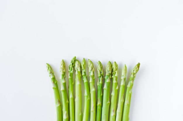 Fresh raw asparagus, top view, copyspace