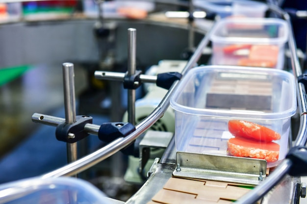Fresh raw beef steak in boxes transfer on automated for package.