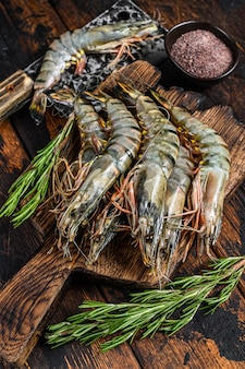 Fresh raw black tiger prawns, shrimps on a cutting board