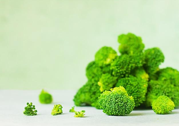 Fresh raw broccoli on vitage green