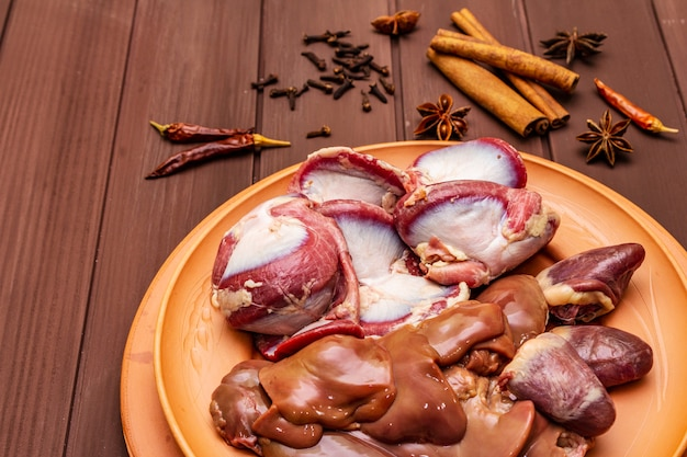 Fresh raw duck offal with dry spices