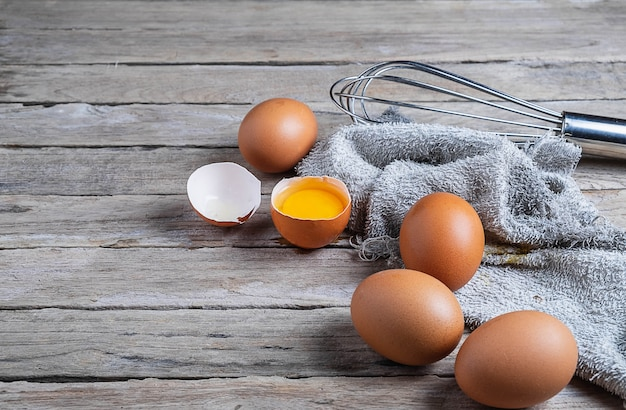 Fresh raw eggs on a wooden table