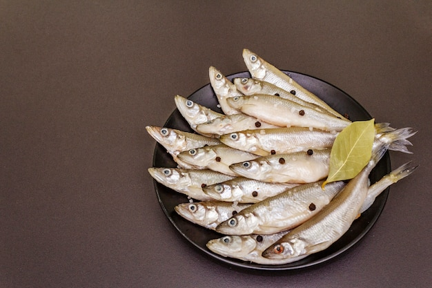 Fresh raw fish smelt or sardines ready for cooking