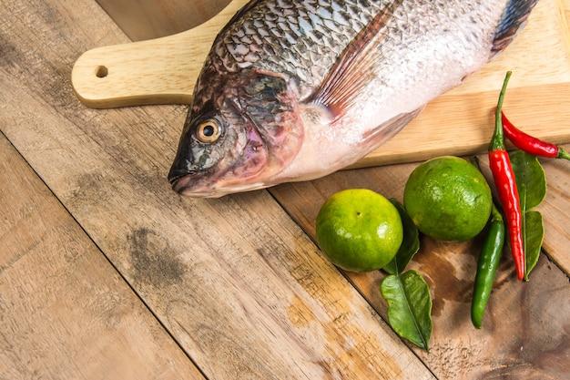 Fresh raw fish on the wood