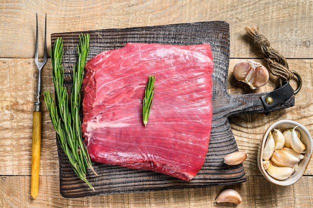 Fresh raw flank or bavette beef marbled meat steak with rosemary