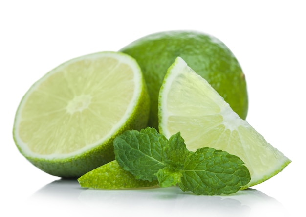 Fresh raw lime with mint leaf on white