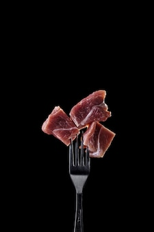 Fresh and raw meat on a fork