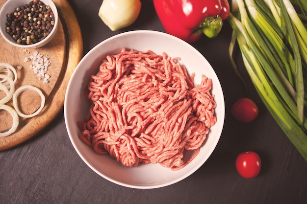 Fresh raw mince. minced beef in a white bowl