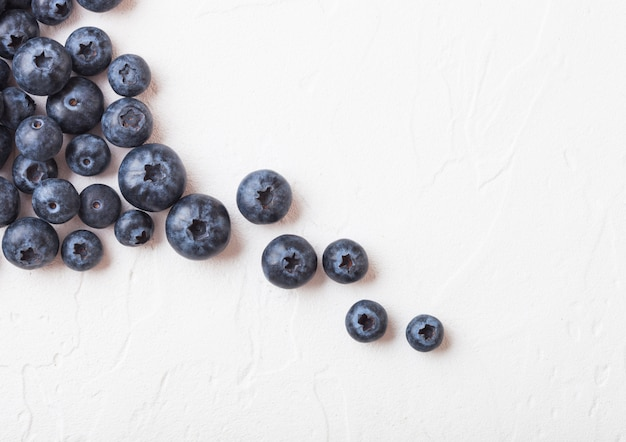 Fresh raw organic blueberries on white background.