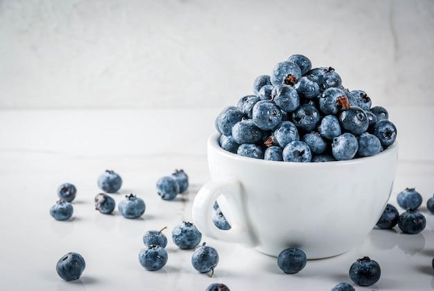 Fresh raw organic farm blueberry in white cup