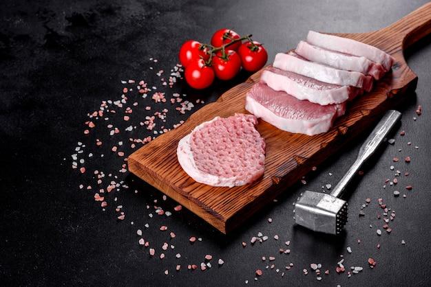 A fresh raw piece of pork escalop cut into several parts