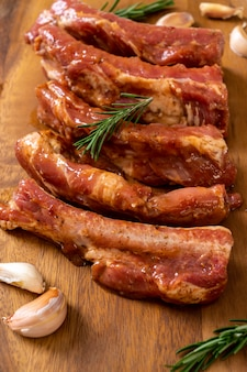 Fresh raw pork ribs ready for roasting with ingredients