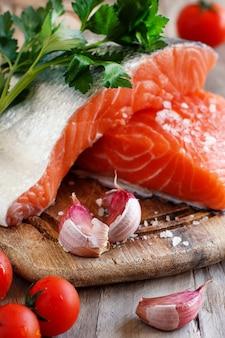Fresh raw salmon on a wooden cutting board
