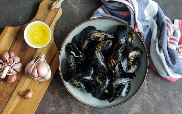 Fresh raw sea mussels with garlic ready to be cooked