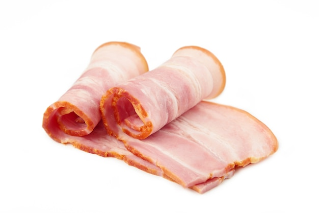 Fresh raw slices bacon isolated on white background. roll of bacon. top view