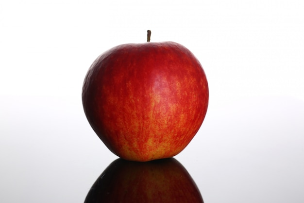 Fresh red apple on a background