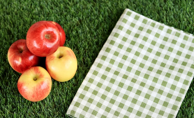 Fresh red apple on a green grass