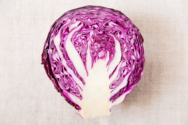 Fresh red cabbage. tablecloth. closeup view. food concept