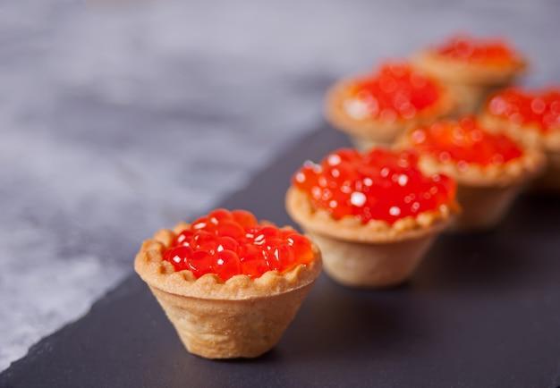 Fresh red caviar in tartlets. delicatessen. gourmet food